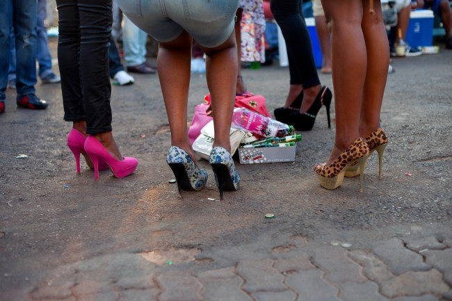 STILETTOS : 02/2013A group of ladies identify a spot to lay their alcohol and stand. They surround their goods and enjoy the music. Hurricanes, Kathlehong.